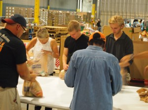 Kerry Blomquist works with her sons Eric and Mike on the assembly line.